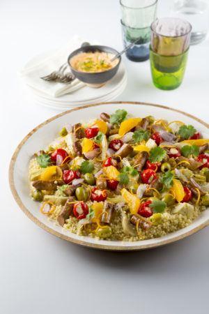 Sharing couscous met merguez en sinas